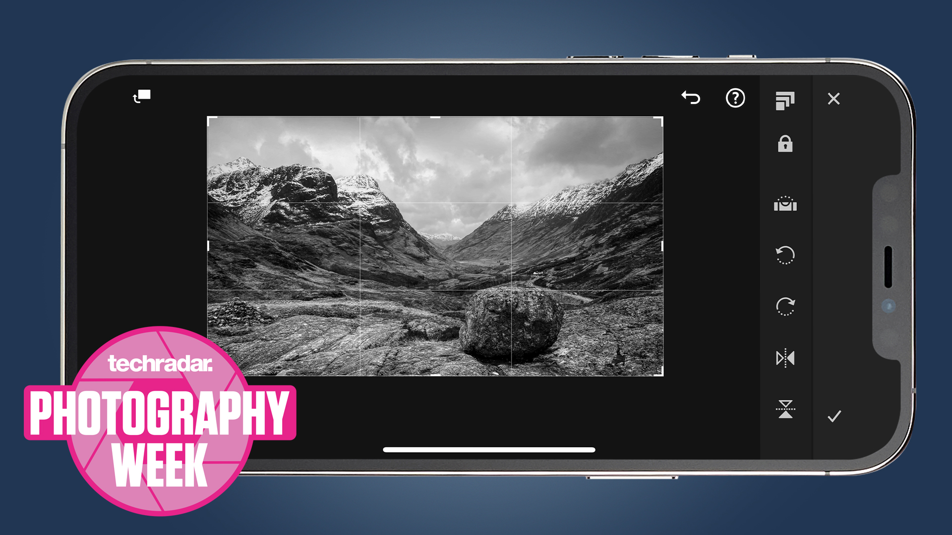 An iPhone shooting a landscape photo in black and white