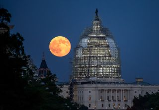 "A ""supermoon"" full moon rises over the U.S. Capitol Building in this NASA photo captured on July 31, 2015. The closest supermoon full moon since 1948 will rise on Monday, Nov. 14, 2016."