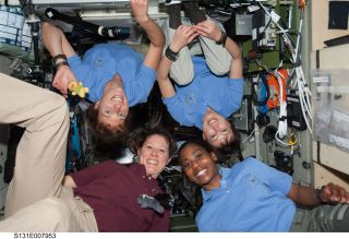 NASA astronauts Tracy Caldwell Dyson (lower left) and Stephanie Wilson (lower right) worked on board the International Space Station in April 2010.