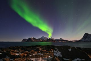 The northern lights shimmer over the Lofoten islands in Norway. A geomagnetic storm may amplify the northern lights on March 14 and 15, 2018.
