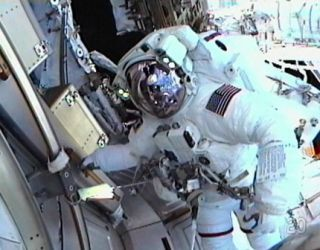 Mission Specialist Drew Feustel works outside the International Space Station, as seen in this view from the helmet camera of Mission Specialist Greg Chamitoff while they conduct the first spacewalk of the STS-134 mission on May 20, 2011 (Flight Day 5).