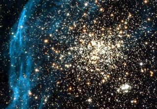 A globular cluster (yellow) shines in the Large Magellanic Cloud, one of the Milky Way's smaller satellite galaxies.