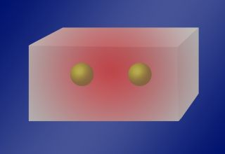 Physicists have found that two or more atoms can absorb a single photon when inside a cavity with standing light waves of a certain frequency (red glow).