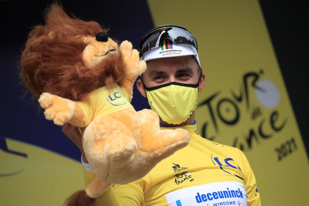 Team Deceuninck Quicksteps Julian Alaphilippe of France celebrates his overall leaders yellow jersey on the podium at the end of the 1st stage of the 108th edition of the Tour de France cycling race 197 km between Brest and Landerneau on June 26 2021 Photo by christophe petit tesson POOL AFP Photo by CHRISTOPHE PETIT TESSONPOOLAFP via Getty Images