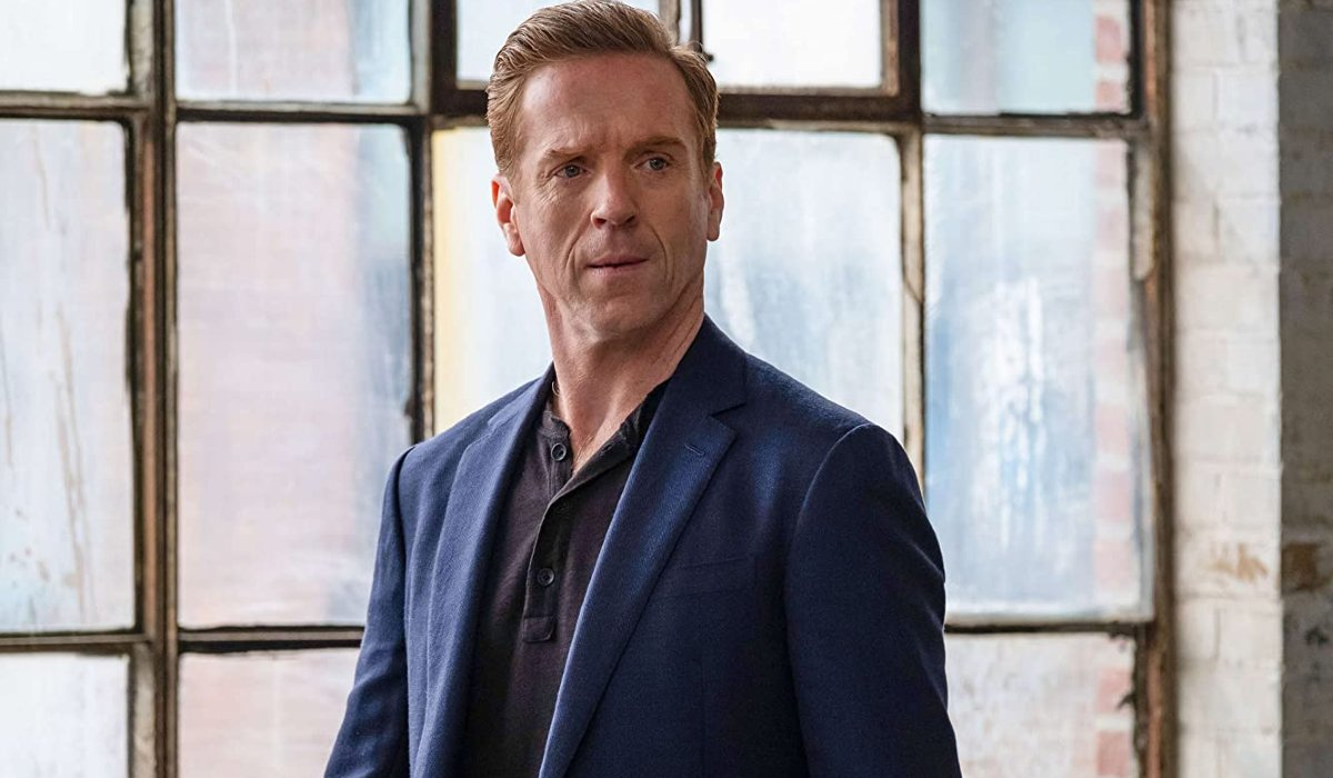 Billions Damian Lewis suited in front of a window