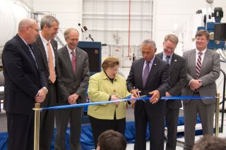 Maryland Sen. Barbara Mikulski and NASA Administrator Charles Bolden cut the ribbon at the new Horizontal Integration Facility at NASA's Wallops Flight Facility, Wallops Is., Va.