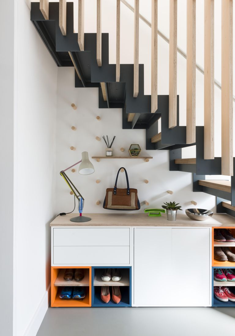Under stairs storage using peg boards