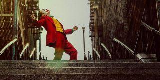 Joaquin Phoenix dancing on stairs as Joker
