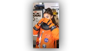 Singer Ariana Grande dons a NASA spacesuit during a visit to Mission Control at NASA's Johnson Space Center in Houston on May 18, 2019.