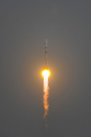 Soyuz lifts off for the first time from Europe's Spaceport in French Guiana carrying the first two Galileo In-Orbit Validation satellites, on October 21, 2011.