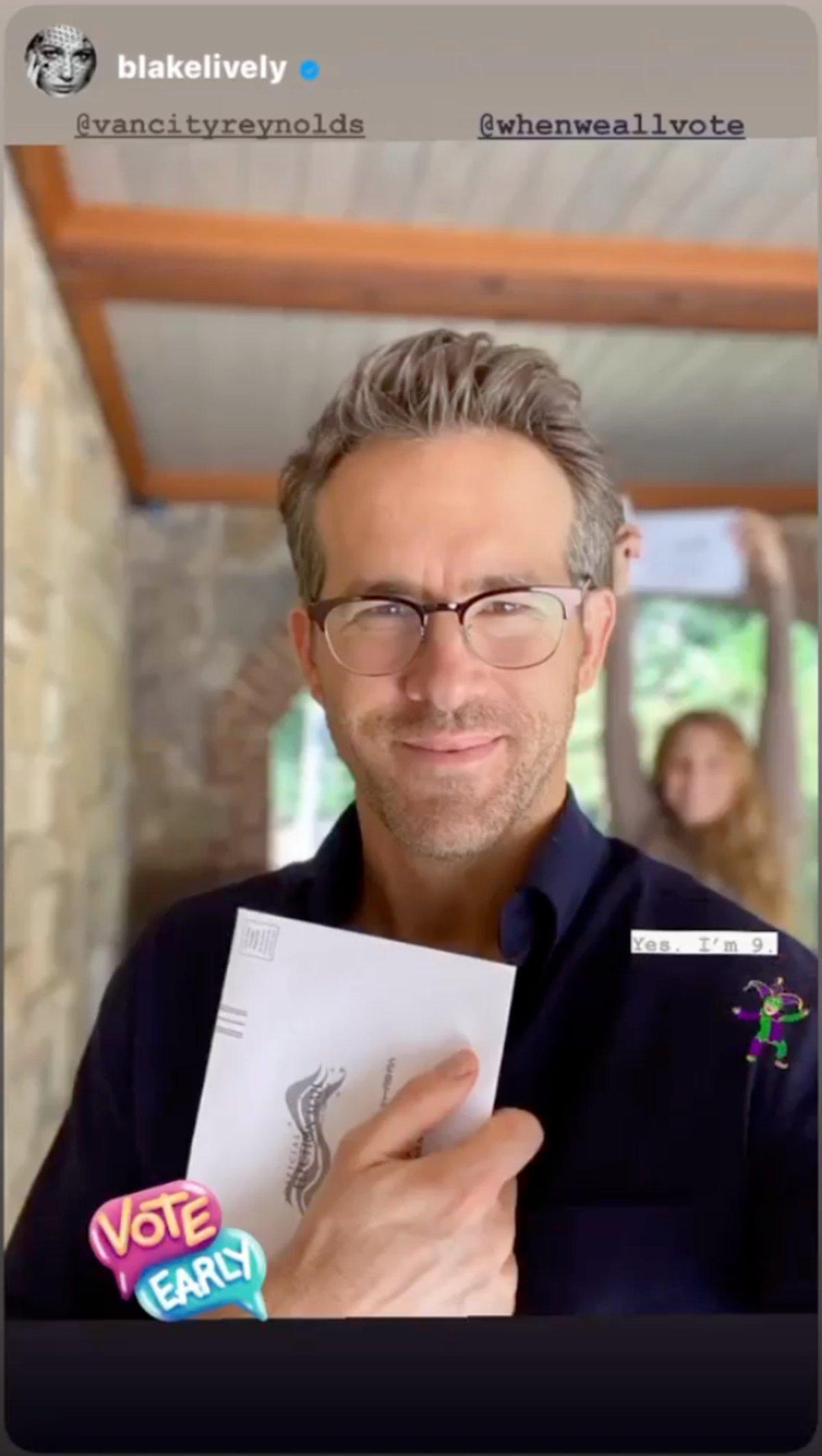 Ryan Reynolds holding his ballot proudly