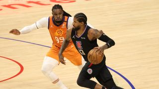 Paul George #13 of the LA Clippers drives against Jae Crowder #99 of the Phoenix Suns during the second half in Game Six of the Western Conference Finals at Staples Center on June 30, 2021 in Los Angeles