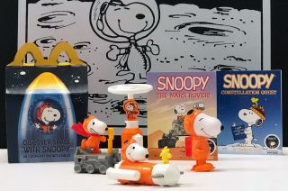 "The ""Discover Space with Snoopy"" McDonald's Happy Meal comes with books and toys that feature the Peanuts comic strip dog and which promote NASA's missions and STEM education."