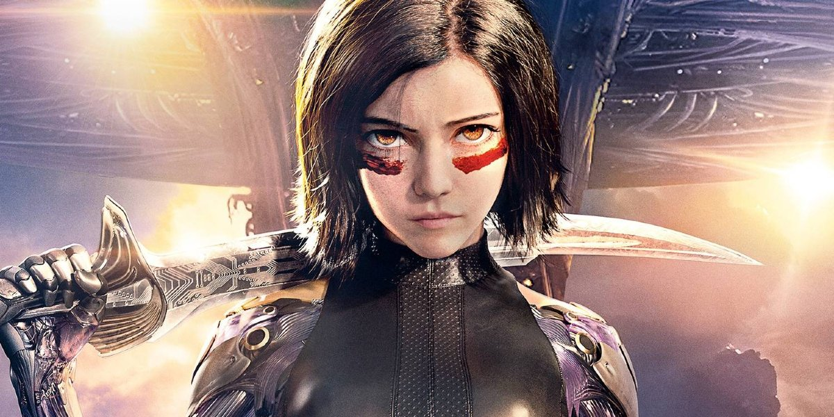 Alita: Battle Angel Alita stands with the Damascus Blade with Zalem in the background.