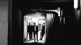 Black and white group shot of Van der Graaf Generator in a doorway