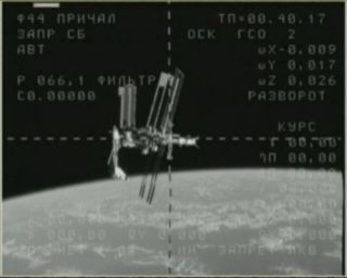 This still from NASA TV shows the space shuttle Endeavour (at left) while it is docked at the International Space Station on May 23, 2011 during the shuttle's final spaceflight before being retired. A video camera on a Russian Soyuz spacecraft caught this