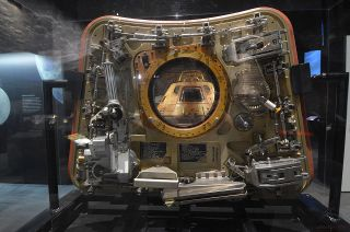 """Columbia,"" the Apollo 11 command module, is seen through the window of its crew hatch as displayed in the Smithsonian exhibition ""Destination Moon: The Apollo 11 Mission"" now at The Museum of Flight in Seattle for the flight's 50th anniversary."