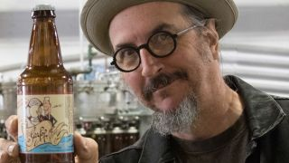 Primus frontman Les Claypool poses with a bottle of his SeaPop soft drink