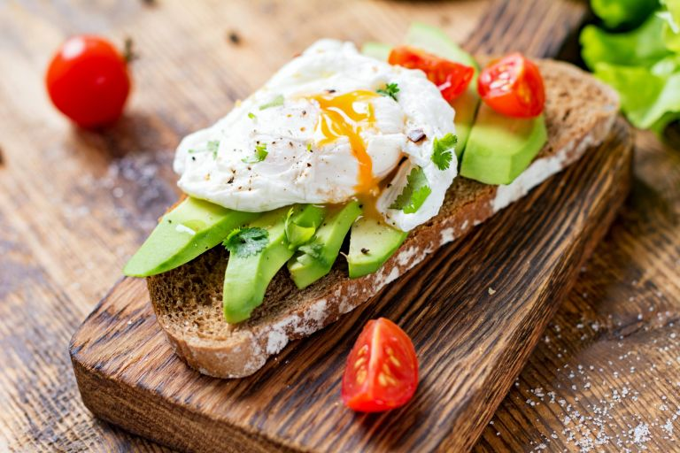 Poached egg and tomatoes on avocado toast