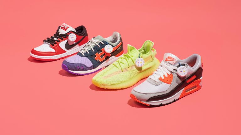 Four sneakers on pink background