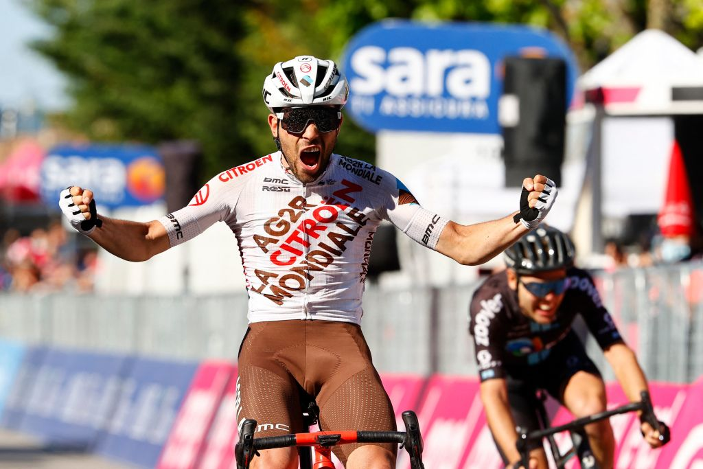 Team AG2R rider Italys Andrea Vendrame celebrates as he crosses the finish line to win the twelfth stage of the Giro dItalia 2021 cycling race 212 km between Siena and Bagno di Romagna on May 20 2021 Photo by Luca Bettini AFP Photo by LUCA BETTINIAFP via Getty Images