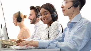 woman in a call center using a voip phone