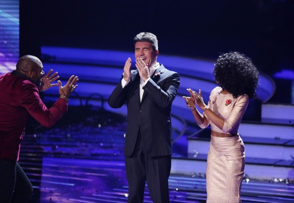 Simon Cowell reacts after being inadvertently headbutted by contestant Anto Stephans