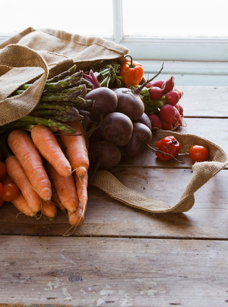 Bag with vegetables carrots tomatoes asparagus-boost your metabolism