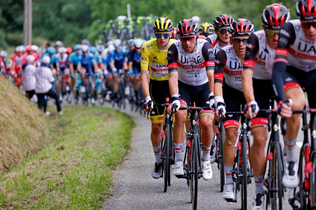 Team UAE Emirates Tadej Pogacar of Slovenia wearing the overall leaders yellow jersey 1stL rides in the pack during the 16th stage of the 108th edition of the Tour de France cycling race 169 km between Pas De La Case and SaintGaudens on July 13 2021 Photo by Thomas SAMSON AFP Photo by THOMAS SAMSONAFP via Getty Images