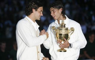 Wimbledon 2008 - Day 13 Roger Federer of Switzerland congratulates Rafael Nadal of Spain in winning the Championship trophy