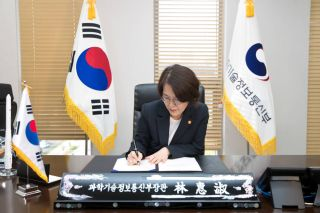 Republic of Korea Minister of Science and ICT Lim Hyesook signs the Artemis Accords during a ceremony in Seoul on May 24, 2021.