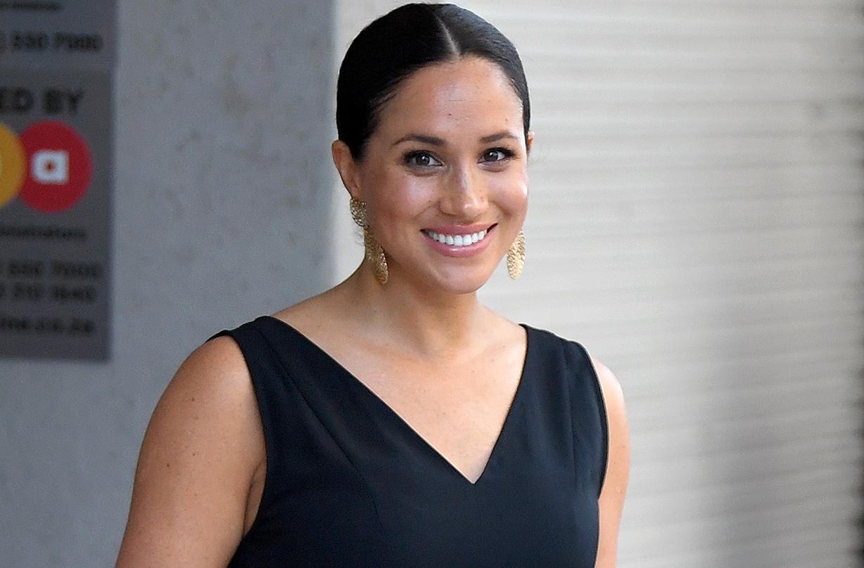 duchess meghan rewears affordable black everlane jumpsuit royal tour