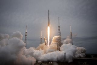 A SpaceX Falcon 9 v1.1 rocket blasts off for the International Space Station carrying an unmanned Dragon cargo ship on April 18, 2014. The mission launched from Cape Canaveral Air Force Station in Florida and is SpaceX's third cargo delivery for NASA.