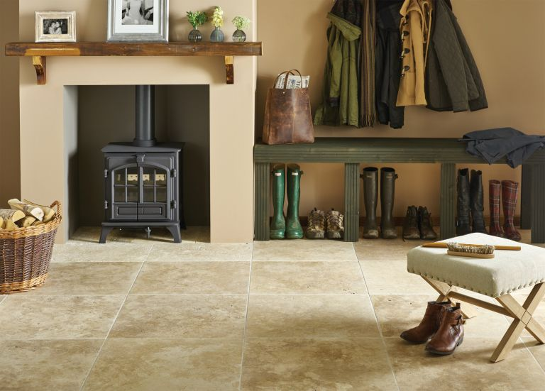 Stone Floor in hallway with fireplace and boot store