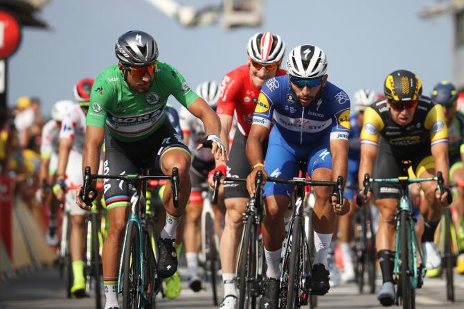 Peter Sagan and Fernando Gaviria cross the line during stage 4 at the Tour de France