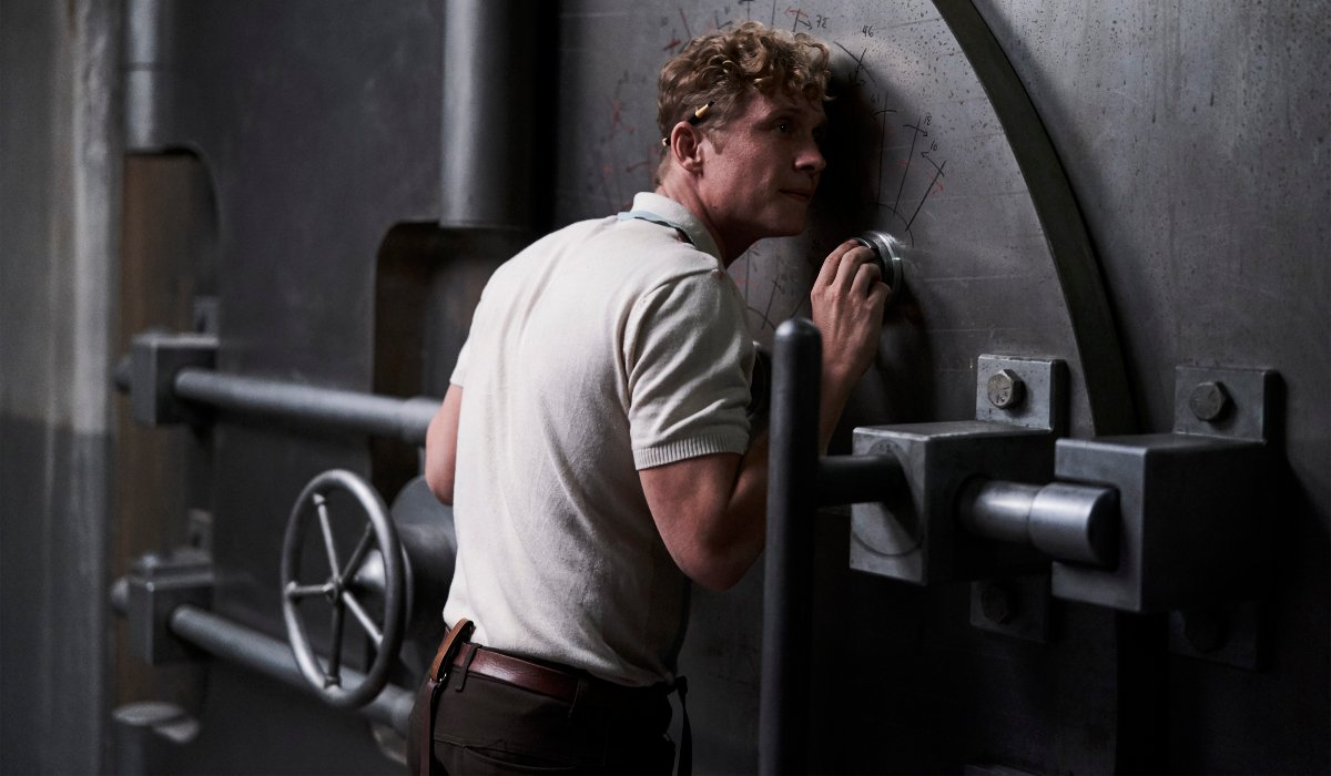 Matthias Schweighöfer works at cracking the safe in Army of the Dead.