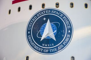The U.S. Space Force emblem as seen on the payload fairing of a United Launch Alliance Atlas V rocket during launch operations for the AEHF-6 military communications satellite in March 2020.