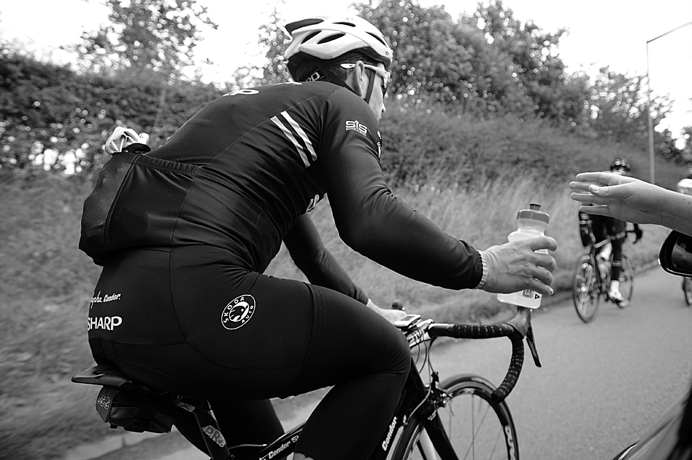 Graham Briggs takes a drink, Rapha Condor Sharp training in Peak District, August 2011