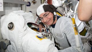 NASA astronaut Mark Vande Hei does a spacesuit fit check to prepare for an upcoming spacewalk at the International Space Station.