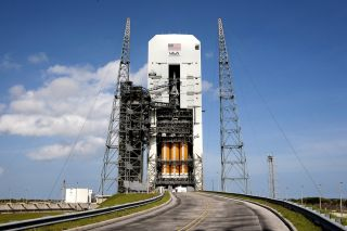 NASA's Orion capsule sits atop a United Launch Alliance Delta 4 Heavy rocket inside the Mobile Service Tower at Florida's Cape Canaveral Air Force Station ahead of its first test flight, which is scheduled to take place on Dec. 4, 2014.