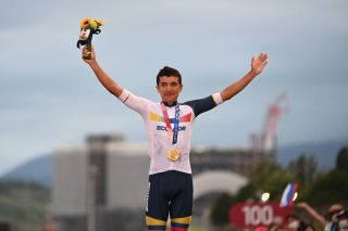Gold medallist Ecuador's Richard Carapaz celebrates his victory on the podium during the medal ceremony for the mens cycling road race of the Tokyo 2020 Olympic Games