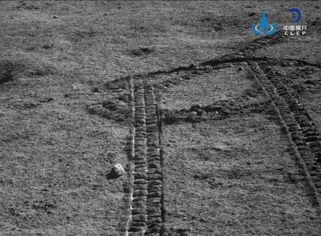 Yutu-2 looks back over tracks it made in the lunar soil.