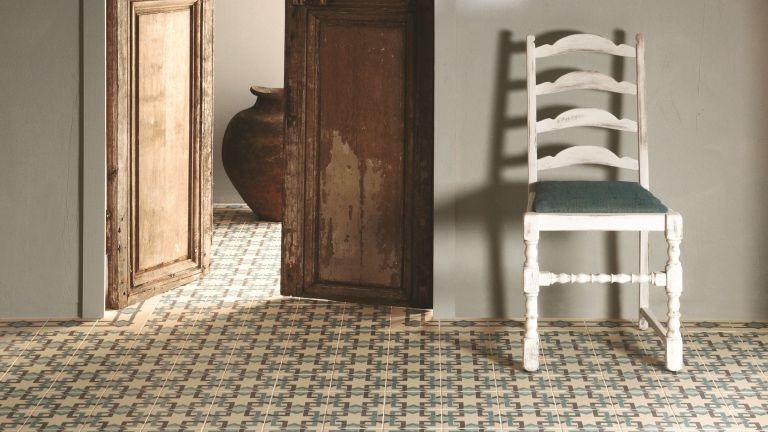 Clean encaustic floor tiles flooring in a hallway