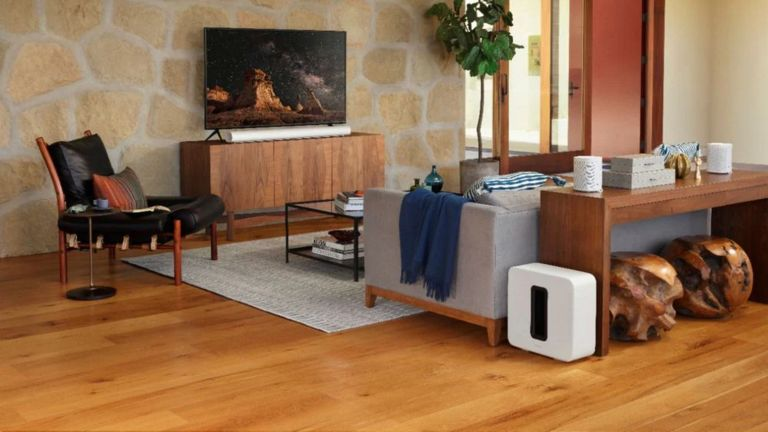 best surround sound system: Sonos Arc soundbar connected to Sonos One rear speakers and subwoofer in brown living room