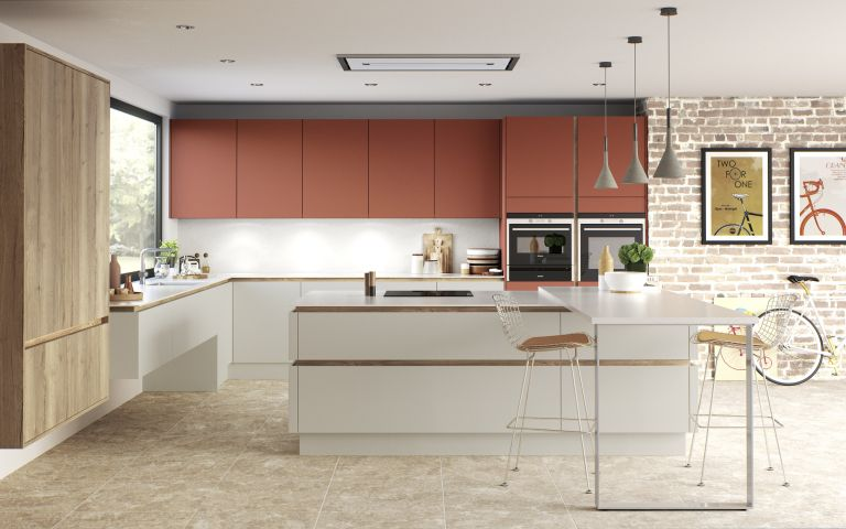 handleless kitchen with coloured cabinets and copper finishes