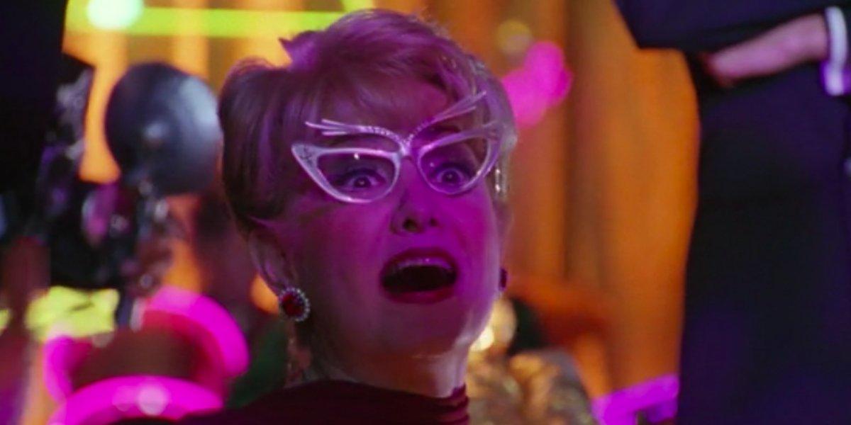 Elizabeth Sanders as Gossip Gerty in Batman & Robin