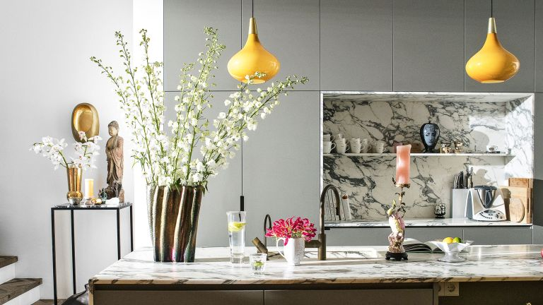 Roost episode 5 - a grey and yellow kitchen with marble splashbacks and kitchen island - Credit Future