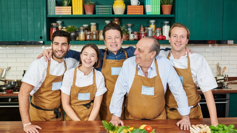 Jamie Oliver Cooking School offer: Jamie and chefs standing in kitchen