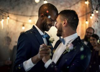 two grooms dance at their wedding
