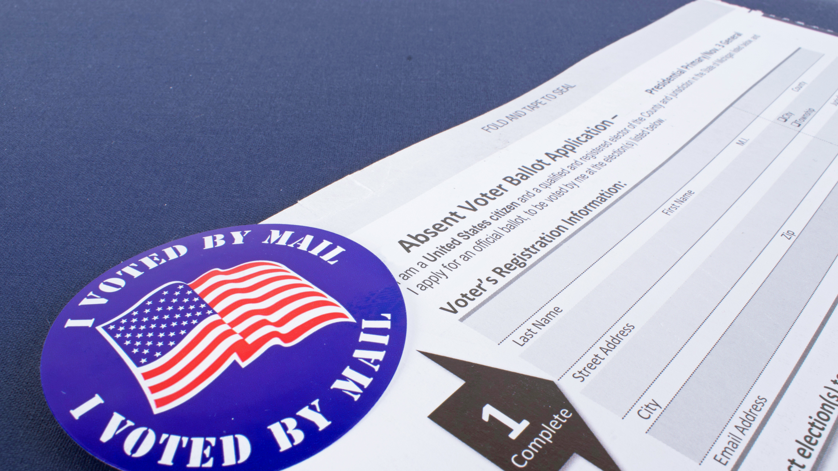 An absentee ballot to vote by mail.